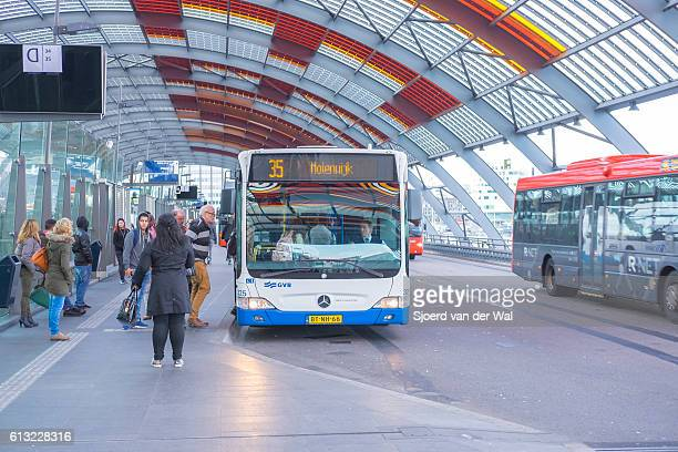 "amsterdam bus station with people boarding the busses - ""sjoerd van der wal"" stock pictures, royalty-free photos & images"