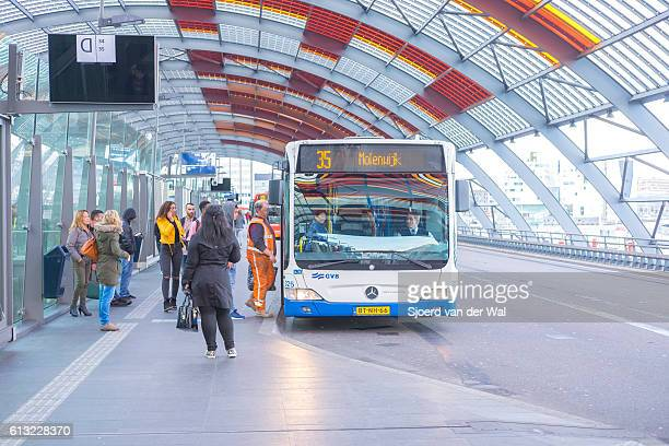 """amsterdam bus station with people boarding the busses - """"sjoerd van der wal"""" stock pictures, royalty-free photos & images"""