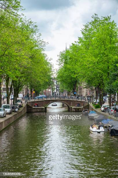 """amsterdam canal during summer with a pedal tour boat - """"sjoerd van der wal"""" or """"sjo"""" stock pictures, royalty-free photos & images"""