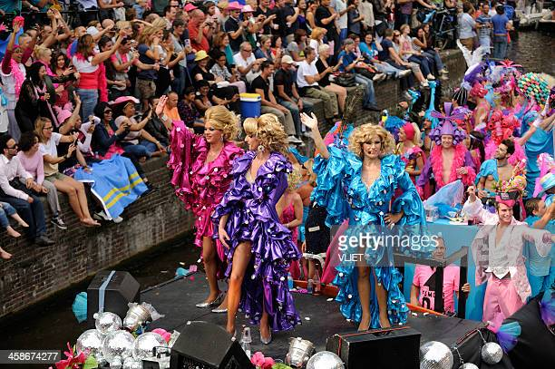amsterdam canal parade - crossdressing party stock photos and pictures