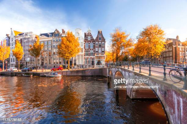 amsterdam canals sunset - amsterdam stock pictures, royalty-free photos & images
