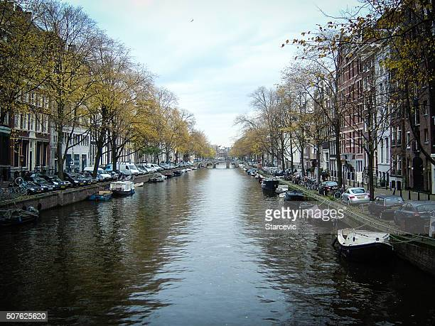 Amsterdam canals with colorful homes and boats