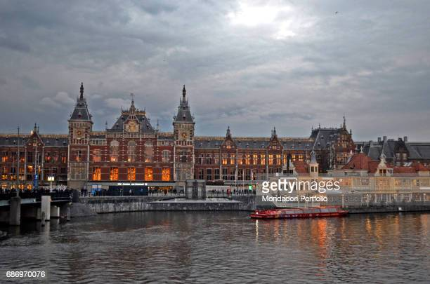Amsterdam Central Station at dusk near the port on IJ on the northern side of the city and the new area The official opening was on 15th October 1889...