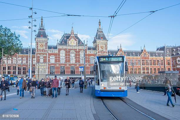 """amsterdam central station panorama with people walking in the square - """"sjoerd van der wal"""" stock pictures, royalty-free photos & images"""