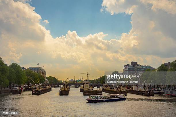 Amsterdam city ships in a canal. Amstel canal river
