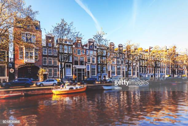 amsterdam cityscape with canal and bridges in netherlands - amsterdam stock pictures, royalty-free photos & images
