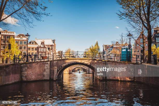 Amsterdam cityscape with canal and bridges in Netherlands