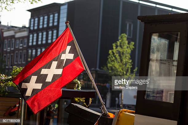 amsterdam crosses flag at anne frank house - anne frank house stock pictures, royalty-free photos & images