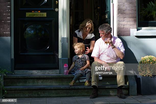 Amsterdam, Holland: Family on Front Stoop with Drinks
