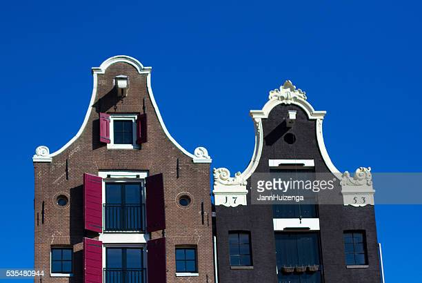 Amsterdam, Holland: Gables of Two Old Houses Against Blue Sky