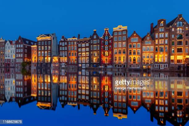 amsterdam houses reflection in the canal - amsterdam stock pictures, royalty-free photos & images