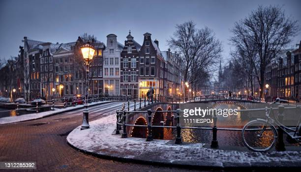 amsterdam in snow - amsterdam stock pictures, royalty-free photos & images