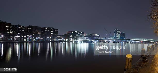 Amsterdam Java-eiland and Jan Schaeferbrug skyline at night, panorama
