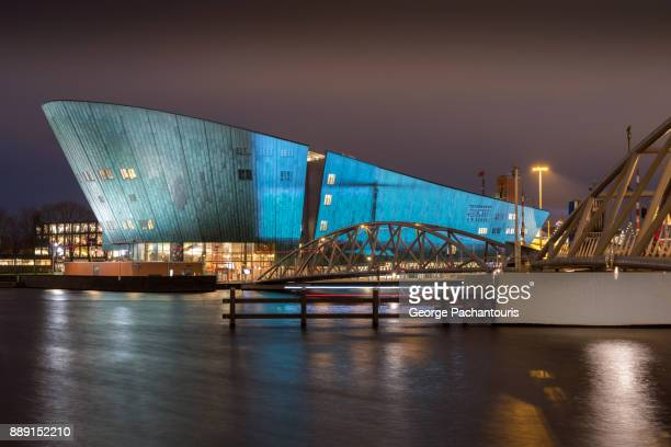 amsterdam light festival on nemo science museum, amsterdam, netherlands - nemo museum stock pictures, royalty-free photos & images