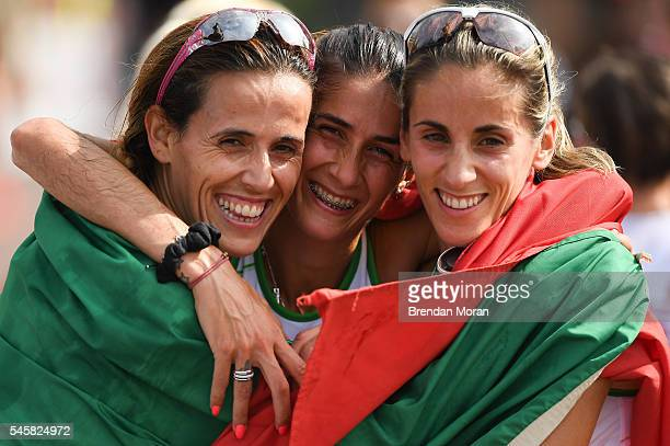 Amsterdam Netherlands 10 July 2016 Sara Moreira centre of Portugal celebrates winning gold in the Women's Half Marathon with teammates Dulce Félix...