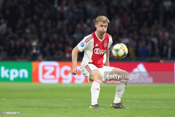 Amsterdam Netherlands 23th April 2019 Ajax midfielder Frenkie de Jong runs with the ball during the game against SBV Vitesse for a match in the Dutch...
