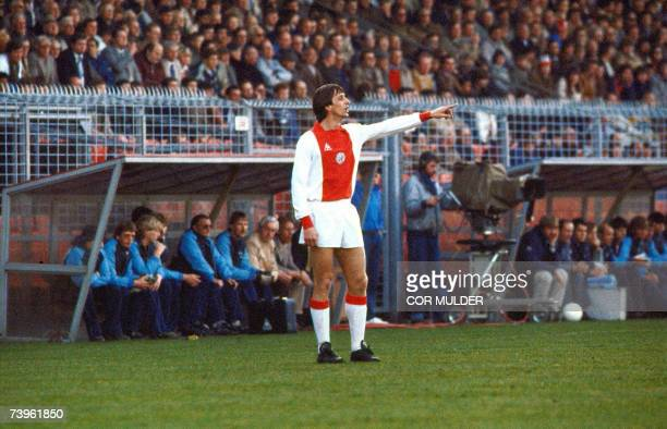 A picture taken 04 April 1982 shows Dutch football star Johan Cruijff giving directions during the match Ajax vs NEC in Amsterdam Johan Cruijff will...