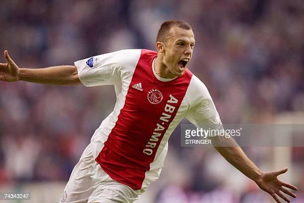 Ajax Amsterdam's John Heitinga cheers after scoring 10 against AZ Alkmaar 27 May in Amsterdam Amsterdam Ajax Amsterdam scored three second half goals...