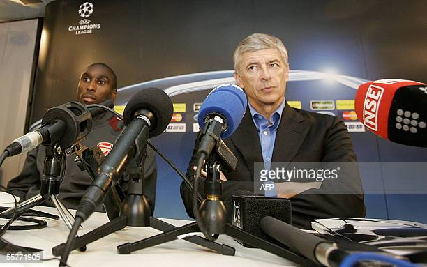 Arsenal coach Arsene Wenger and captain Sol Campbell listen at a press conference at Amsterdam Schiphol Airport prior to their Champions League...