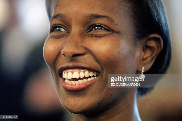 Amsterdam, NETHERLANDS: Ayaan Hirsi Ali, a Somali-born Dutch former politician and critic of Islam, 29 September 2006 in Amsterdam smiles during the...