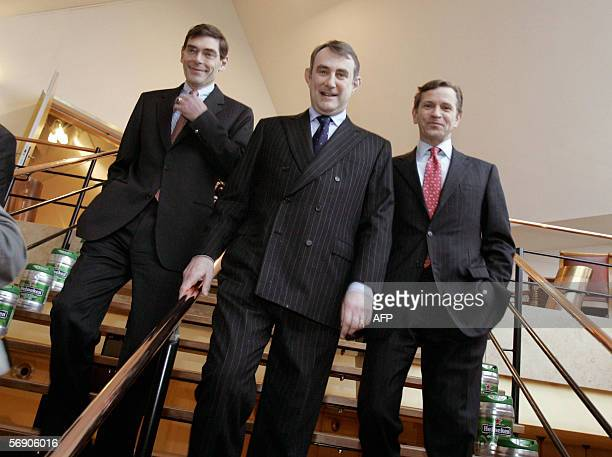From left Dutch brewer Heineken's Chief Financial Officer and board member Rene Hooft Graafland Chairman and Chief Executive Officer JeanFrancois van...
