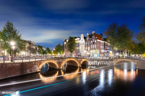 Amsterdam Netherlands in Europe with circle tunnel under the bridge over the Keizersgracht canal.