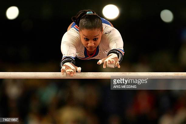 Katheleen Lindor of France performs on the uneven bars during the final of the 2nd European Artistic Gymnastics individual championship in Amsterdam...