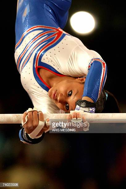 Katheleen Lindor of France performs on the uneven bars during the final of the 2007 European Artistic Gymnastics individual championship in Amsterdam...