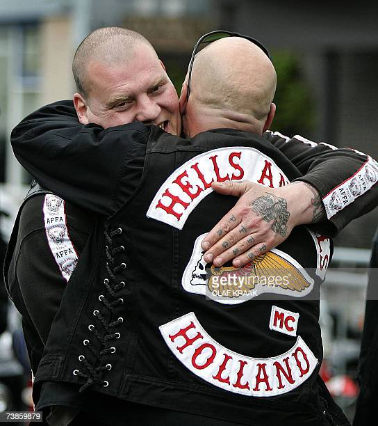 Members of the Amsterdam chapter Hells Angels motorcycle club hug eachother outside the courthouse in Amsterdam after a court ruled against banning...