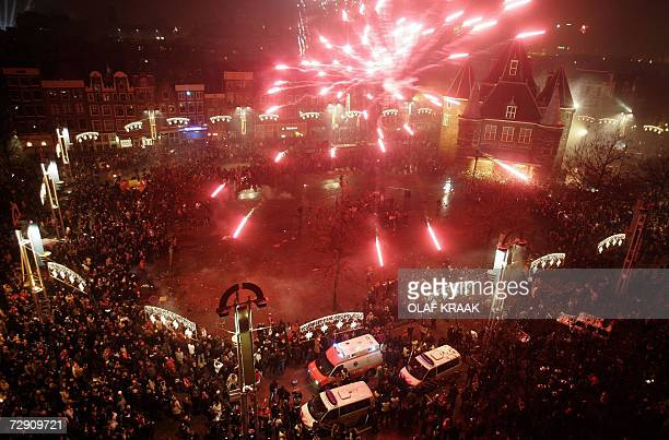 People celebrate the New Year in Amsterdam early 01 January 2007 in Amsterdam AFP PHOTO OLAF KRAAK ** NETHERLANDS OUT **