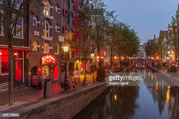 amsterdam, netherlands - red light district stock-fotos und bilder