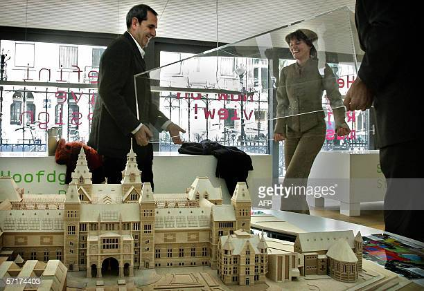 State Secretary for Education Culture and Science Medy van der Laan looks with Spanish architect Antonio Ortiz and managing director of the...