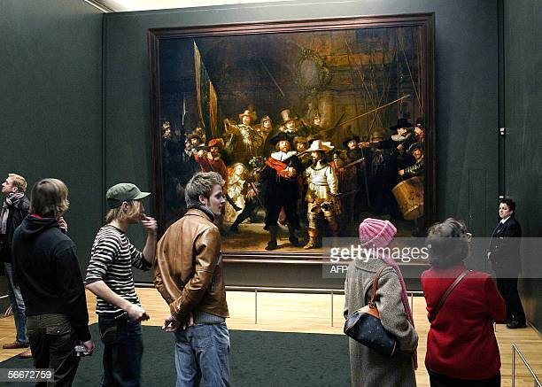Visitors look at Dutch artist Rembrandt van Rijn's famous 'Night Watch' painting in Amsterdam's Rijskmuseum 26 January 2006 Amsterdam is banking on...