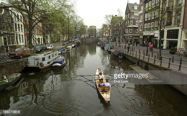 Amsterdam one of the most colurful cities in the world pics of the Prinsengracht with the Westertoren next to the Anne Frank she mentions counting...