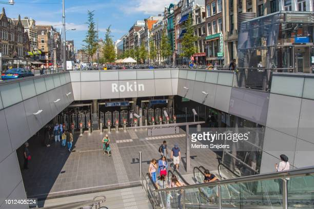 amsterdam rokin metrostation below street level - merten snijders stock pictures, royalty-free photos & images