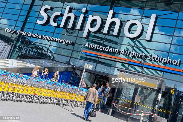 amsterdam schiphol airport entrance - schiphol airport stock photos and pictures