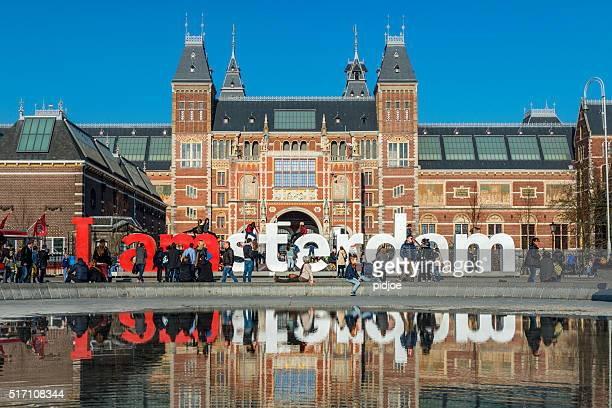 I amsterdam sign at Museumplein, Rijksmuseum in the back