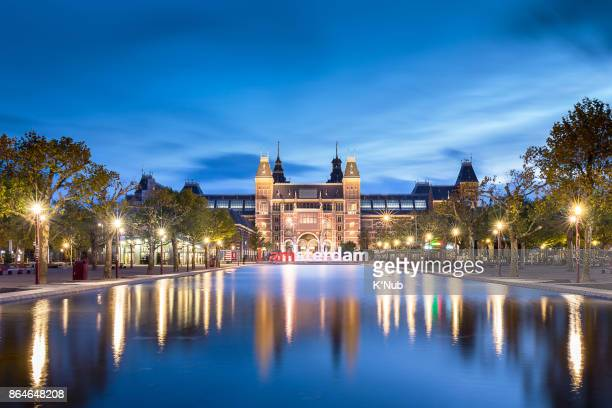 i amsterdam sign in front of the rijksmuseum museum in amsterdam netherlands europe with sunset time - rijksmuseum stock photos and pictures