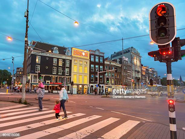 Amsterdam street life at sunset with a family on a zebra crossing with traffic light