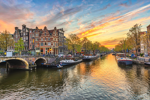 Amsterdam sunset city skyline at canal waterfront, Amsterdam, Netherlands 868776864