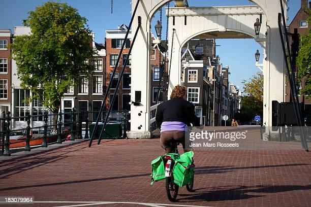 Amsterdam The Netherlands Daily life Healthy life bike, biker Old bridge, street, no cars Blue september sky
