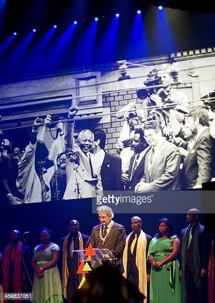 Amsterdam's Mayor Eberhard van der Laan speaks on stage with the Cape Town Opera choir on December 15, 2013 at the Stadsschouwburg theater in...