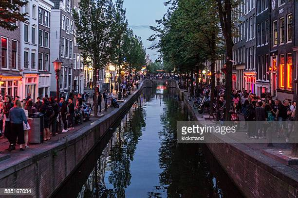 amsterdam's red light district - red light district stock-fotos und bilder