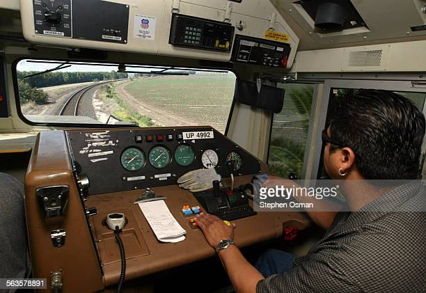 Amtrack Engineer Rick Rodriquez guides his 398000 lbs 4200 horsepower locomotive along farm fields in Camarillo Metrolink as part of the SoCal Rail...