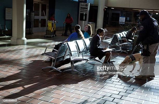 Amtrak Police Officer Edward Ross and his K9 Zeta who is trained in vapor wake explosives detection patrol the passenger waiting areas during...