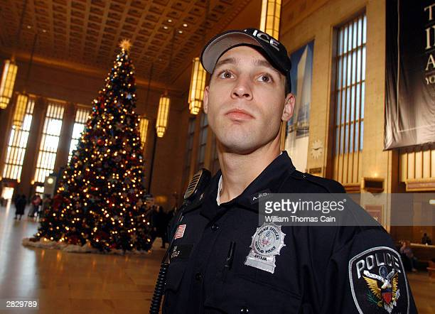 Amtrak Police Officer Eric J Wolf patrols 30th Street Station December 23 2003 in Philadelphia Pennsylvania US authorities intensified security...