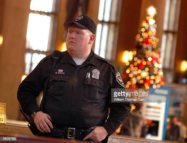 Amtrak Police Officer Gerald Arntz patrols 30th Street Station December 23 2003 in Philadelphia Pennsylvania US authorities intensified security...