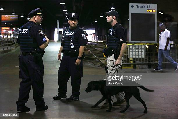 Amtrak Police officers patrol after a news conference at Union Station October 4 2012 in Washington DC A new partnership among the Department of...
