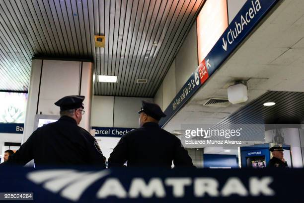 Amtrak Police officers stand guard as TSA workers test the new devices designed to detect explosives at New York City's Penn Station on February 27...