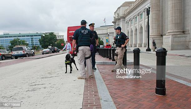 Amtrak police officers stand guard at the front of Union Station as they conduct enhanced security operations around the area as a proactive measure...